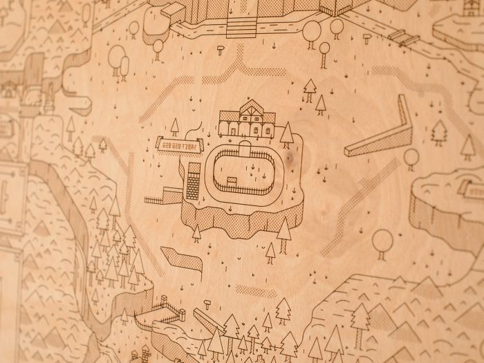 Laser etched wooden maps of Hyrule by Alex Griendling