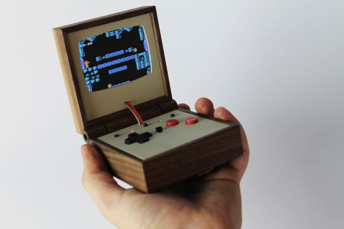 PE358 - Pocket sized portable game system by Love Hultén