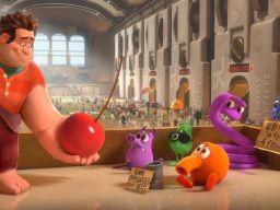 Disney's Wreck-It Ralph (left) offers cherries to an out-of-work Q*bert.